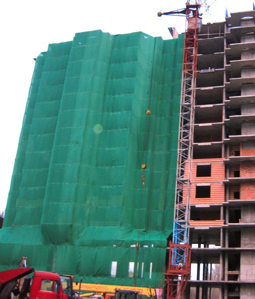 монтаж фасадной сетки при строительстве